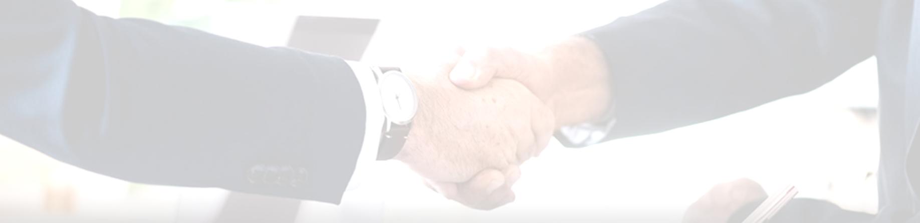 Handshake grey narrow.jpg